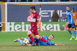 September 26, 2018 - Bronx, New York, US - New York City FC midfielder ALEXANDER RING (8) slides in to take the ball away from Chicago Fire midfielder BRANDT BRONICO (13) during a regular season match at Yankee Stadium in Bronx, New York.  New York City FC defeats Chicago Fire 2 to 0 (Credit Image: © Mark Smith/ZUMA Wire)