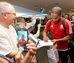 DINARD, FRANCE - Thursday, July 7, 2016: Wales' captain Ashley Williams signs autographs as the team are welcomed back to their hotel, the Novotel Thalasso Dinard, by staff and patrons, after the Semi-Final of the UEFA Euro 2016 Championship against Portugal. (Pic by David Rawcliffe/Propaganda)