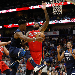 Nov 29, 2017; New Orleans, LA, USA; Minnesota Timberwolves guard Jimmy Butler (23) passes away from New Orleans Pelicans center DeMarcus Cousins (0) and forward Anthony Davis (23) during the second quarter of a game at the Smoothie King Center. Mandatory Credit: Derick E. Hingle-USA TODAY Sports
