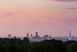 Hampstead Heath, London, July 20th 2016. Seen from Hampstead Heath in North London, the first rays of the sun illuminate the skyscrapers in The City. &copy;Paul Davey<br /> FOR LICENCING CONTACT: Paul Davey +44 (0) 7966 016 296 paul@pauldaveycreative.co.uk