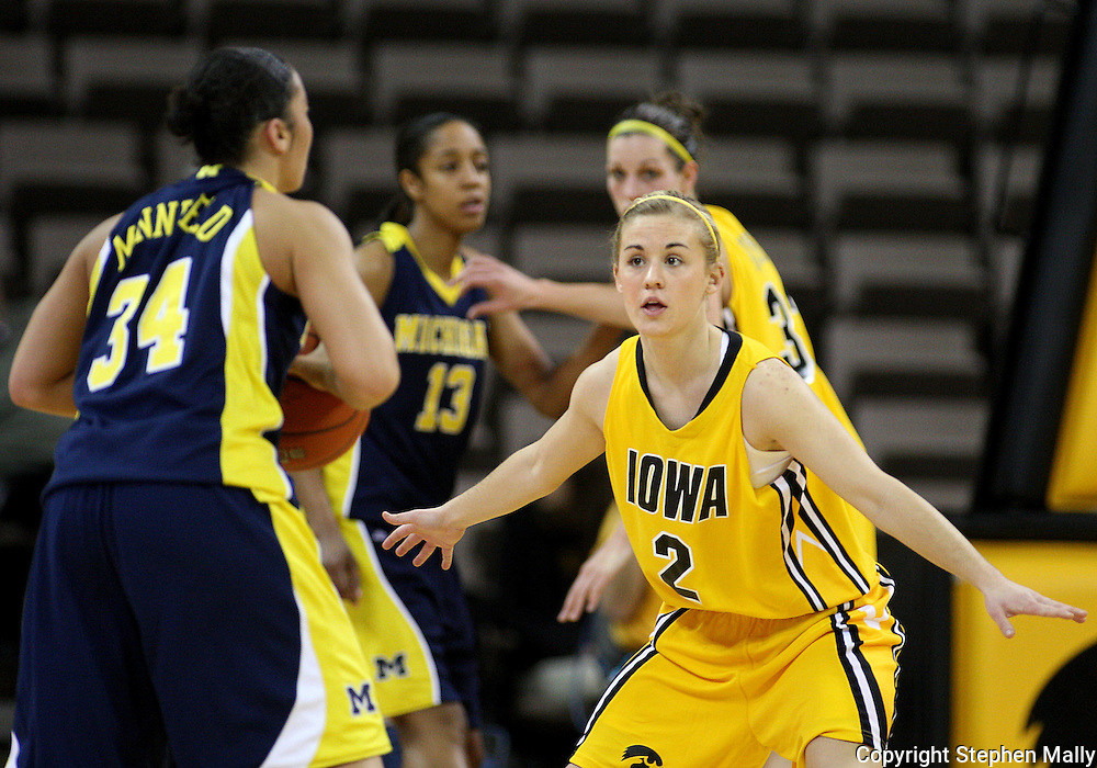 26 JANUARY 2009: Iowa guard Kamille Wahlin (2) defends Michigan guard Jessica Minnfield (34) during the first half of an NCAA women's college basketball game Monday, Jan. 26, 2009, at Carver-Hawkeye Arena in Iowa City, Iowa. Iowa defeated Michigan 77-69.