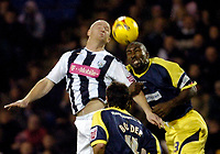 Photo: Leigh Quinnell.<br /> West Bromwich Albion v Derby County. Coca Cola Championship. 02/12/2006. West Broms John Hartson jumps with Derbys Darren Moore.