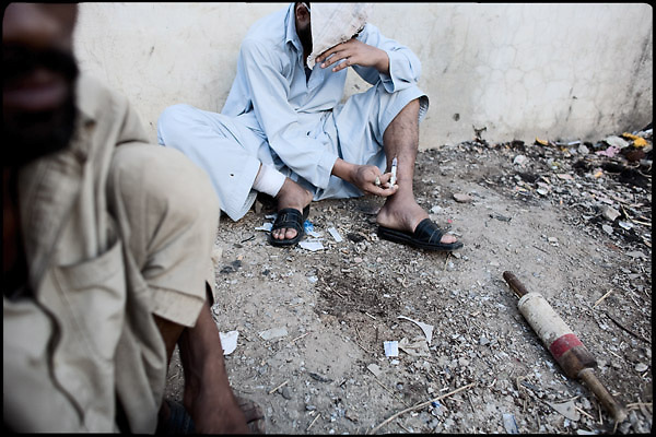 "Heroin injection. A guy from the middle class is having his dose of drug in Morgh Mandi, one of the most crowded places by the druggies of Rawalpindi. Pakistan, on thursday, August 14 2008.....""Pakistan is one of the countries hardest hits by the narcotics abuse into the world, during the last years it is facing a dramatic crisis as it regards the heroin consumption. The Unodc (United Nations Office on Drugs and Crime) has reported a conspicuous decline in heroin production in Southeast Asia, while damage to a big expansion in Southwest Asia. Pakistan falls under the Golden Crescent, which is one of the two major illicit opium producing centres in Asia, situated in the mountain area at the borderline between Iran, Afghanistan and Pakistan itself. .During the last 20 years drug trafficking is flourishing in the Country. It is the key transit point for Afghan drugs, including heroin, opium, morphine, and hashish, bound for Western countries, the Arab states of the Persian Gulf and Africa..Hashish and heroin seem to be the preferred drugs prevalence among males in the age bracket of 15-45 years, women comprise only 3%. More then 5% of whole country's population (constituted by around 170 milion individuals),  are regular heroin users, this abuse is conspicuous as more of an urban phenomenon. The substance is usually smoked or the smoke is inhaled, while small number of injection cases have begun to emerge in some few areas..Statistics say, drug addicts have six years of education. Heroin has been identified as the drug predominantly responsible for creating unrest in the society."""
