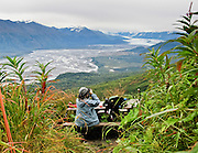 See Knik Glacier and River from a hike on Pioneer Ridge, Alaska, USA. To reach the trailhead from Anchorage, head north on the Glenn Highway, exit onto Old Glenn Hwy, and just before crossing the river, turn onto Knik River Rd for almost 4 miles to trail parking signed on right.
