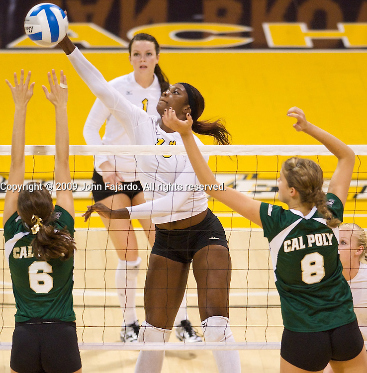 Michelle Osunbor(18)  attacks the block of Molly Pon(6) and Jennifer Keddy(8) in the Big West Conference game against Cal Poly at the Walter Pyramid, Long Beach CA, Saturday Oct. 3, 2009.