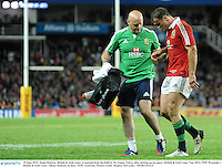 15 June 2013; Jamie Roberts, British & Irish Lions, is assisted from the field by Dr. Eanna Falvey after picking up an injury. British & Irish Lions Tour 2013, NSW Waratahs v British & Irish Lions, Allianz Stadium, Sydney, NSW, Australia. Picture credit: Stephen McCarthy / SPORTSFILE