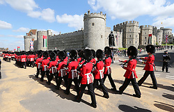 Guards march past Windsor Castle for the state visit of The President of the United Arab Emirates, Sheikh Khalifa bin Zayed Al Nahyan. Tuesday, 30th April 2013 Photo by: Stephen Lock / i-Images