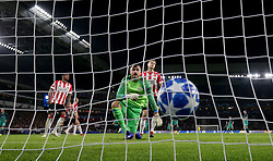PSV Eindhoven's goalkeeper Jeroen Zoet (centre) reacts after Tottenham Hotspur's Lucas Moura (obscured) scores his side's first goal of the game