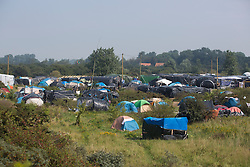 © Licensed to London News Pictures. 30/08/2015. Calais, France. A general view of the refugee camp in Calais, also known as the Jungle. Tomorrow the French PM, Manuel Valls, will visit the day centre Jules Ferry at the camp. Photo credit : Isabel Infantes/LNP