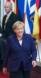 Angela Merkel, Germany's chancellor, departs after the euro-zone summit in Brussels, Belgium, on Friday, May 7, 2010. (Photo © Jock)