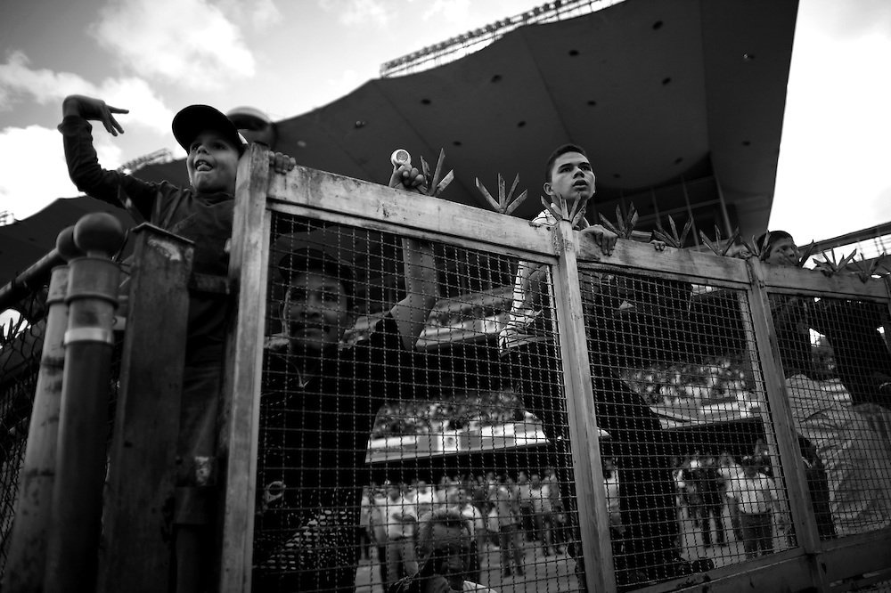 In this photo taken Dec. 5, 2010, fans watch a horse race during the Caribbean Classic Series at the Rinconada racetrack in Caracas, Venezuela.