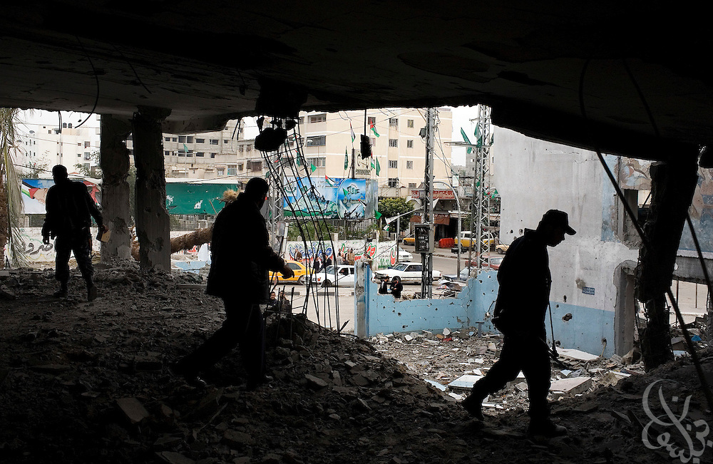 HAMAS Policemen inspect the remains of their police station that was destroyed during the recently ended military operation by the Israelis against HAMAS January 19, 2009 in Gaza City . During the 21 day operation , Israel specifically targeted members of the HAMAS forces and  heavily damaged the groups infrastructure.