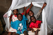 L-R Joanita, Putelesi, Ignacious, Musaline. Children at the home of Joseph and Tina Gariseb pose for photos under their new net. Malaria Agents with Nets for Life distributing mosquito nets in the New Location in Tsumeb, Northern Namibia. November 16th 2010. .Picture by Zute Lightfoot www.lightfootphoto.com