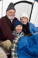 Grandparents with grandson tent, portrait