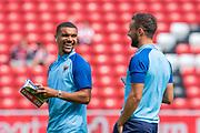 Kwesi Appiah (#9) and Luke O'Neill (#2) of AFC Wimbledon share a joke before the EFL Sky Bet League 1 match between Sunderland and AFC Wimbledon at the Stadium Of Light, Sunderland, England on 24 August 2019.