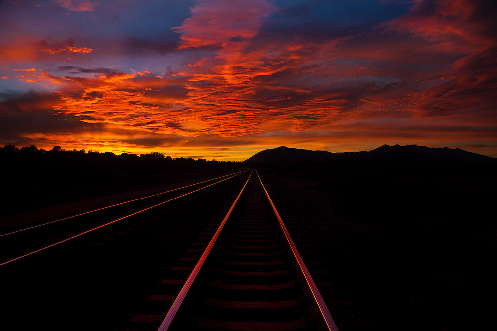 train tracks, going west towards Flagstaff, Arizona, with San Francisco Peaks at horizon