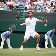 LONDON, ENGLAND - JULY 12:  Marin Cilic of Croatia in action against Gilles Muller of Luxembourg in the Mens' Singles Quarter Final match on Court One during the Wimbledon Lawn Tennis Championships at the All England Lawn Tennis and Croquet Club at Wimbledon on July 12, 2017 in London, England. (Photo by Tim Clayton/Corbis via Getty Images)