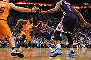 Apr 1, 2016; Phoenix, AZ, USA; Washington Wizards guard John Wall (2) handles the ball in front of Phoenix Suns guard Archie Goodwin (20) in the first half at Talking Stick Resort Arena. The Washington Wizards won 106-99. Mandatory Credit: Jennifer Stewart-USA TODAY Sports