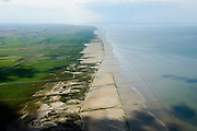 Nederland, Friesland, Gemeente Ferweradeel, 05-08-2014; <br /> Noorderleeg (Noarderleech) ook Noard-Fryslan Butendyks , buitendijkse polder en kweldergebied grenzend aan het Friesche Wad. Landaanwinning door middel van zogenaamde  kwelderwerken. Donkere wolken boven de polders.<br /> <br /> Land reclamation, Noorderleeg (Northern Void), polder and salt marsh area outside the dikes. The so-called salt marsh works consist of square sections, bordered by brushwood breakwaters causing the sludge to settle.<br /> luchtfoto (toeslag); aerial photo (additional fee required); foto Siebe Swart / photo Siebe Swart