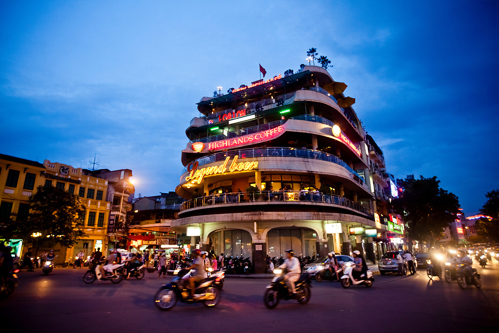 Motorbikes drive past a busy intersection on the northern end of Hoan Kiem Lake in the Old Quarter of Hanoi, Vietnam.