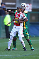 CAPE TOWN, SOUTH AFRICA - 28 MARCH 2010, Granwald Scott  of Ajax Cape Town and Siyanda Zwane of Golden Arrows challenge for the ball  during the Telkom Knock Out match between Ajax Cape Town and Golden Arrows held at Newlands Stadium in Cape Town, South Africa..Photo by: Shaun Roy/Sportzpics