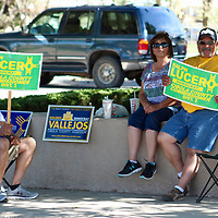 Daniel and Marcella Lucero of San Rafael and John Lucero of Albuquerque stump for family member Ralph Lucero, a District 3 candidate for the Cibola County Board of Commissioners, Tuesday afternoon across from the Old Cibola County Complex on West High Street in Grants.