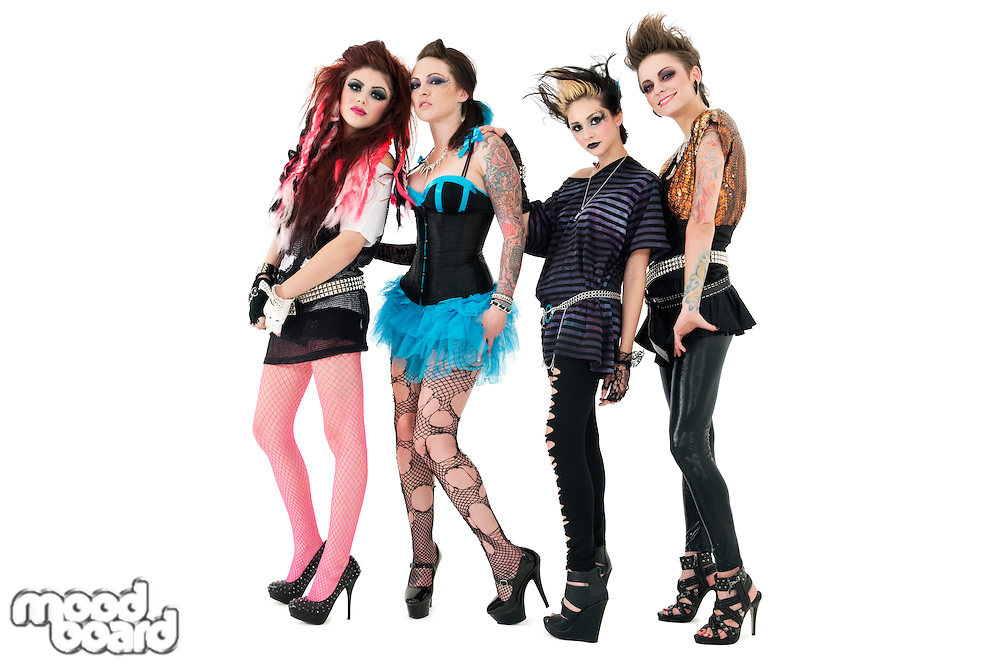 Portrait of beautiful all female rock band over white background