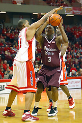 18 January 2009:  Brandon Sampay blocks the path of Chris Cooks who wants to take a shot.  Sampay fouls Cooks arm and sends him to the foul line. The Illinois State University Redbirds top the Missouri State Bears 68-56 on Doug Collins Court inside Redbird Arena on the campus of Illinois State University in Normal Illinois