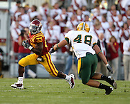 September 3, 2009: Iowa State running back Alexander Robinson (33) tries to get around North Dakota State linebacker Matt Anderson (48) during the first half of the Iowa State Cyclones' 34-17 win over the North Dakota State Bison at Jack Trice Stadium in Ames, Iowa on September 3, 2009.