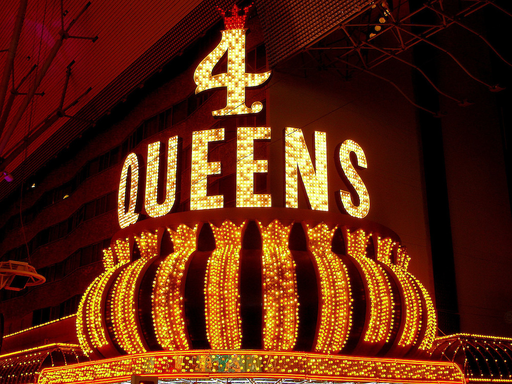 Four Queens Marquee in Downtown Las Vegas, Nevada<br /> Some visitors to Las Vegas love the glitz, glamour and skyscrapers along The Strip. Others prefer to &ldquo;experience&rdquo; the historic casinos downtown like the Four Queens. The hotel and casino opened on Fremont Street in 1966. The developer, Ben Goffstein, named it in honor of his four daughters.  This classic marquee is beneath the Fremont Street Experience canopy.