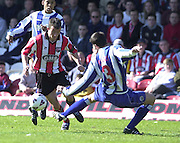 .Photo Peter Spurrier.06/04/2002.Nationwide Div 2.Brentford vs Huddersfield - Griffen Park:.Stephen Hunt go's past Garth Evans..