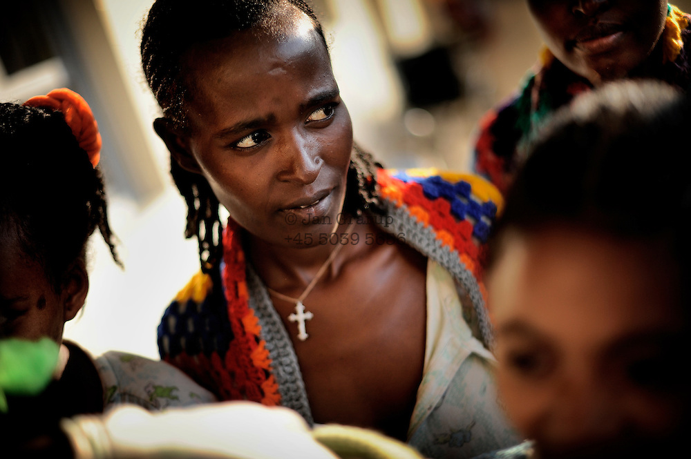 A woman recovering from her operation in the outreach centre of the Hamlin Fistula Hospital, Yirgalem, Southern Ethiopia. The blanket i given to patients on admittance as are all the clothes. All care is free.