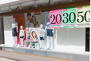 A Mana shop window displaying family clothing and Euro discount prices, on 23rd June 2018, in Celje, Slovenia.