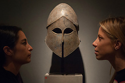 © Licensed to London News Pictures. 29/06/2017. London, UK.  Women view a 6th/5th century BC Greek bronze Corinthian Helmet.  Members of the public visit Masterpiece London, a leading art fair held in the grounds of the Royal Hospital Chelsea.  The fair brings together 150 international exhibitors presenting works from antiquity to the present day and runs 29 June to 5 July 2017.  Photo credit : Stephen Chung/LNP