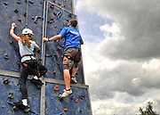 UNITED KINGDOM-LONDON. Climbing the wall at Skyfest 2010. 17/07/2010. STEPHEN SIMPSON...