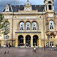 Children Chasing Pigeons at Cercle-Cité in Luxembourg City, Luxembourg <br />