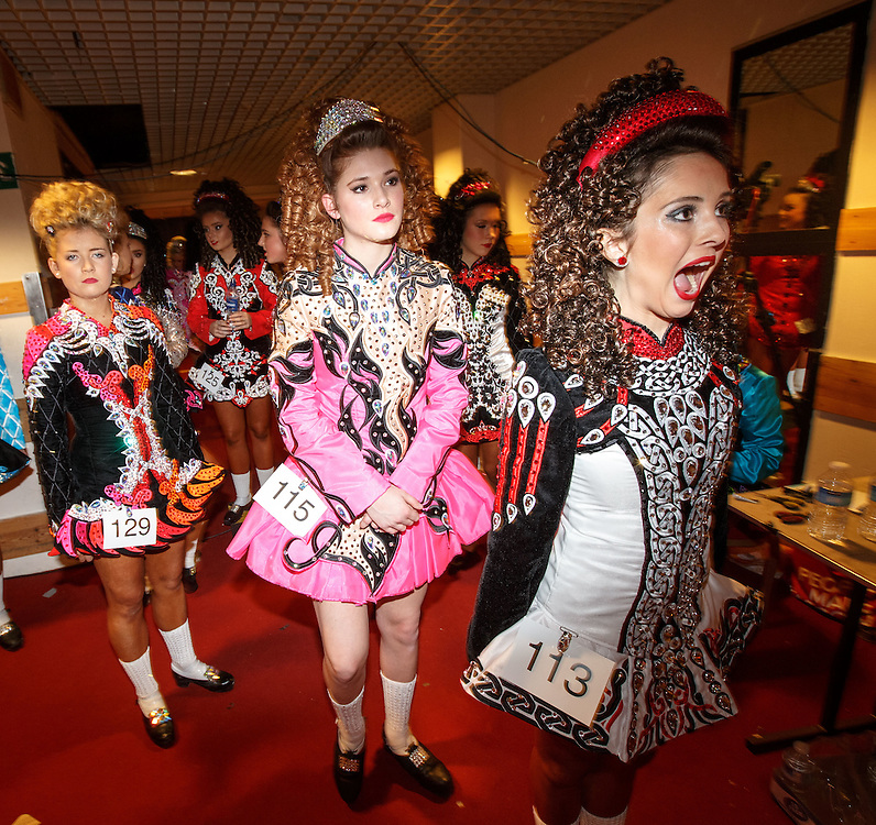 """Belgian Irish Dancer Alicia Bellemans, centre  number 115 (16) prepares to enter the stage. She got to Glasgow for The 46th annual World Irish Dancing Championships at the Glasgow Royal Concert Hall from March 20th- 27th 2016. From Brussels she is the first Belgian to have qualified for the Championships and were not letting the terrorist  attack and airport closures and transport problems beat them to fulfil their passion to compete at Irish Dancing. Alicia said """" We have to do what we love. We won't stop, they won't stop our passion for Irish dancing, we are afraid, but we fight"""". Alicia had to be in Glasgow for her dance slot at 12.30. She has been on the move since 2am and finally got here via Amsterdam.  Picture Robert Perry 23rd March 2016<br /> <br /> Must credit photo to Robert Perry<br /> FEE PAYABLE FOR REPRO USE<br /> FEE PAYABLE FOR ALL INTERNET USE<br /> www.robertperry.co.uk<br /> NB -This image is not to be distributed without the prior consent of the copyright holder.<br /> in using this image you agree to abide by terms and conditions as stated in this caption.<br /> All monies payable to Robert Perry<br /> <br /> (PLEASE DO NOT REMOVE THIS CAPTION)<br /> This image is intended for Editorial use (e.g. news). Any commercial or promotional use requires additional clearance. <br /> Copyright 2014 All rights protected.<br /> first use only<br /> contact details<br /> Robert Perry     <br /> 07702 631 477<br /> robertperryphotos@gmail.com<br /> no internet usage without prior consent.         <br /> Robert Perry reserves the right to pursue unauthorised use of this image . If you violate my intellectual property you may be liable for  damages, loss of income, and profits you derive from the use of this image."""