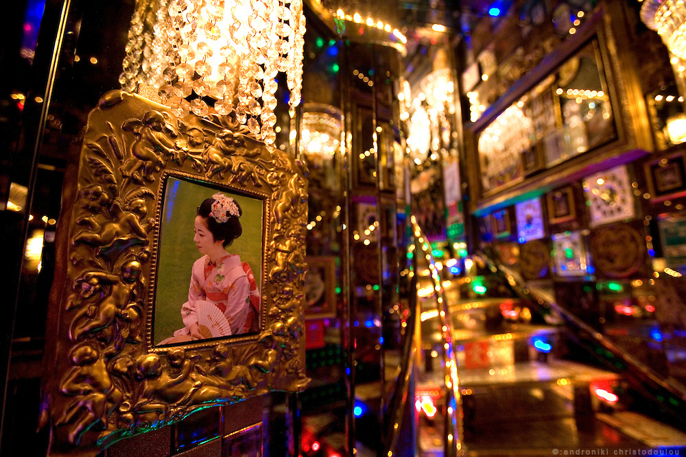 "Decoration with picture of kimono-woman near the entrance of club ""Ai"". Club ""Ai"" (love in Japanese) is one of the oldest host clubs in Kabukicho entertainment area near Shinjuku. It started functioning 37 years ago, with hosts ready to take care of the needs of their female customers. The customers have to pay from 5000 friendly price for beginners, to millions of yen, depending on how good the host is in pleasing the customer and encouraging her to buy drinks. On top of these a good host can receive expensive gifts from his regular customers.  Tokyo - JAPAN"