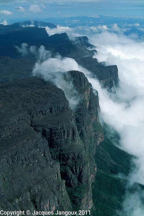 Mountain cliff forming barrier to clouds, Guyana (Guiana) Highlands, Guiana Shield, Pre-Cambrian geological formation, Venezuela