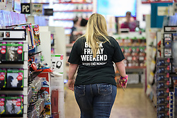 "© Licensed to London News Pictures . 27/11/2015 . Manchester , UK . A member of staff wearing a "" Black Friday Weekend "" t-shirt at a branch of Game in Cheetham Hill in North Manchester this morning (Friday 27th November) . Last year (2014) scuffles and fights were reported amongst queuing bargain-hunters . Photo credit: Joel Goodman/LNP"
