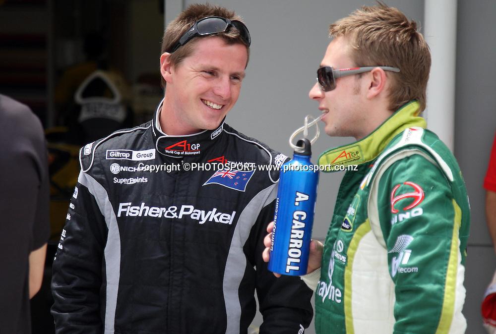 Team NZ driver Jonny Reid talks with Ireland driver Adam Carroll. A1 GP feature race, Taupo, New Zealand, Sunday 20 January 2008. Photo: Andrew Cornaga/PHOTOSPORT