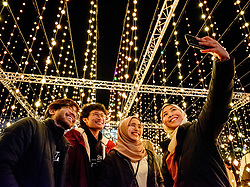© Licensed to London News Pictures. 11/12/2019. (Permission given).The first day of the Submergence lightshow by Squidsoup in Bristol's Millennium Square for Christmas. Submergence is an immersive walkthrough lightshow, where the audience can walk through the hanging lights. It will remain in the square for Christmas and New Year. Photo credit: Simon Chapman/LNP.