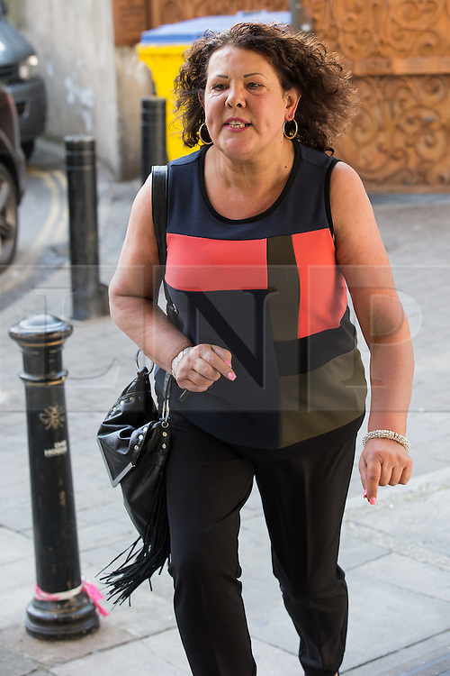 © Licensed to London News Pictures . 11/09/2015 . Manchester , UK . ANITA CREGAN , mother of killer Dale Cregan , outside Manchester Crown Court as she's due for sentence , following pleading guilty to mortgage fraud . Photo credit: Joel Goodman/LNP