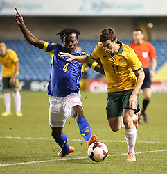 Tommy Oar Australia holds off Juan Carlos Paredes  of Ecuadorl - Photo mandatory by-line: Robin White/JMP - Tel: Mobile: 07966 386802 01/01/2014 - SPORT - FOOTBALL - The Den - Australia v Ecuador - World Cup Warm Up