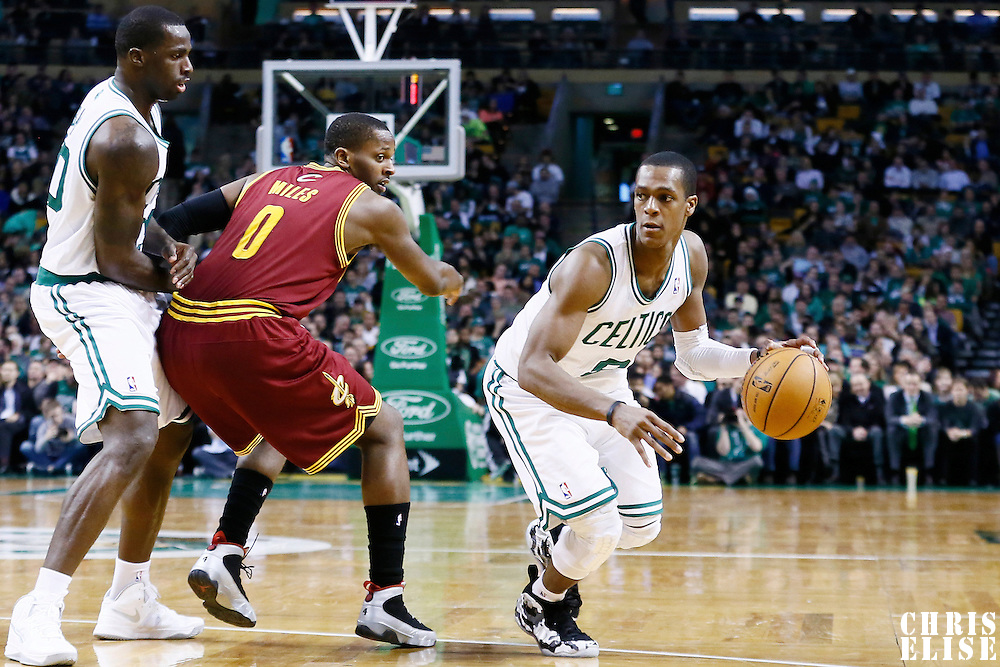 19 December 2012: Boston Celtics point guard Rajon Rondo (9) drives past Cleveland Cavaliers small forward C.J. Miles (0) on a screen set by Boston Celtics power forward Brandon Bass (30) during the Boston Celtics 103-91 victory over the Cleveland Cavaliers at the TD Garden, Boston, Massachusetts, USA.