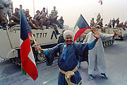 Kuwaiti men dance in the streets as Egyptian coalition forces join in as they celebrate the liberation of Kuwait from Iraqi occupation February 28, 1991 in Kuwait City, Kuwait.