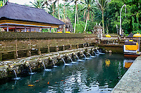 Bali, Gianyar, Tirtha Empul. Pura Tirtha Empul temple close to Tampaksiring. The holy water pours into a pool. The water is said to have magical powers, and all the water for cremations on Bali is taken from this spring.