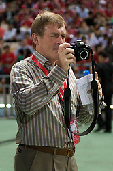 BANGKOK, THAILAND - Wednesday, July 22, 2009: Who's the face behind the camera? Liverpool's Kenny Dalglish takes a photograph during the Reds' preseason friendly match against Thailand at the Rajamangala Stadium. (Pic by David Rawcliffe/Propaganda)