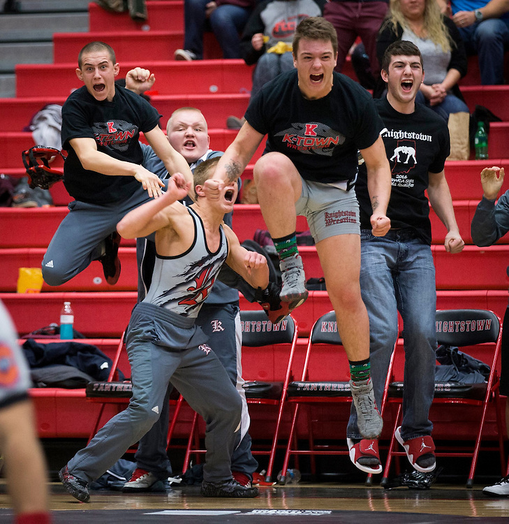 Knightstown wresters celebrate a pin in the final match that gave their team the Henry County Championship title.