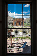 Assay Office in Bannack Ghost Town as viewed through the window of the school house across the street
